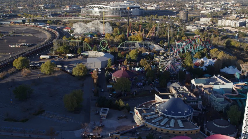 5.7K stock footage aerial video fly over rides at Elitch Gardens at sunrise in Downtown Denver, Colorado Aerial Stock Footage | DX0001_001634