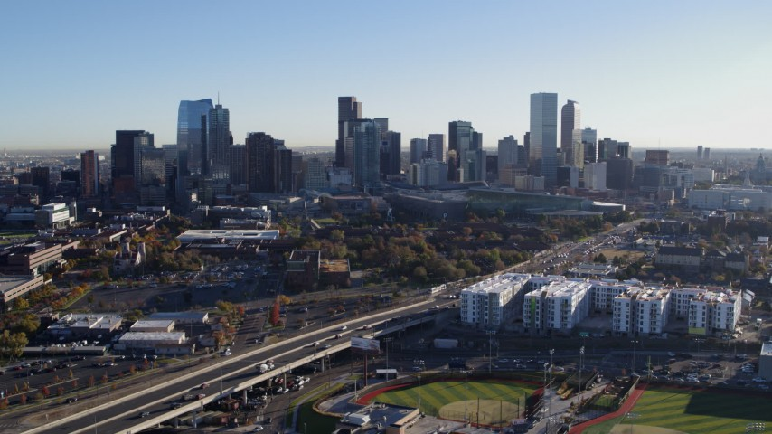 5.7K stock footage aerial video flyby the city skyline at sunrise in Downtown Denver, Colorado Aerial Stock Footage DX0001_001638