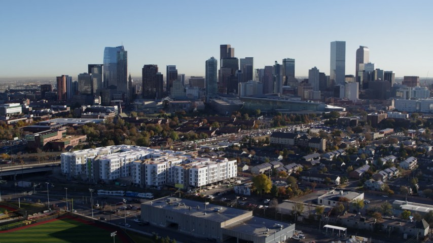 5.7K stock footage aerial video ascend to reveal the city skyline at sunrise in Downtown Denver, Colorado Aerial Stock Footage | DX0001_001644