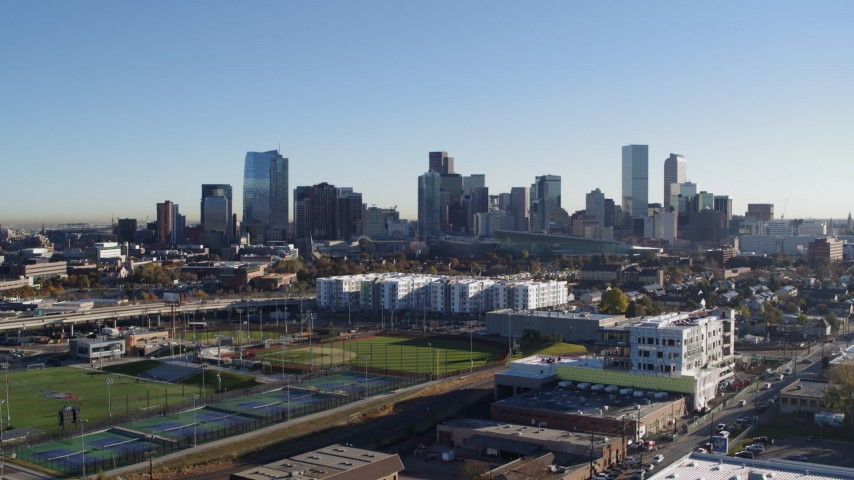 5.7K stock footage aerial video reverse view of the city skyline at sunrise before descent in Downtown Denver, Colorado Aerial Stock Footage | DX0001_001645