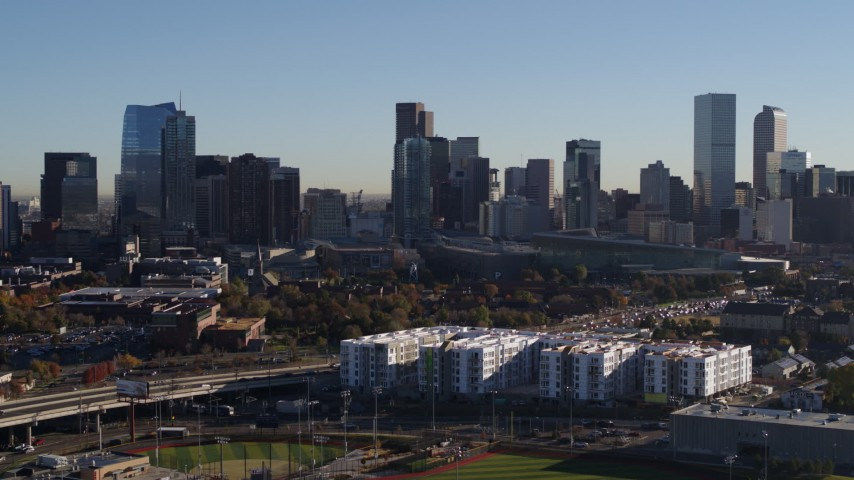 5.7K stock footage aerial video of flying by the city's skyline at sunrise in Downtown Denver, Colorado Aerial Stock Footage   DX0001_001647