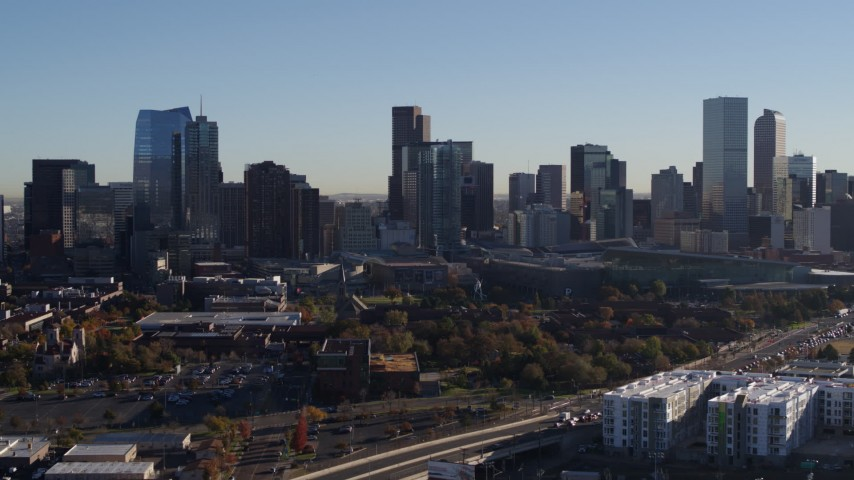 5.7K stock footage aerial video of passing by the city's skyline at sunrise in Downtown Denver, Colorado Aerial Stock Footage | DX0001_001648