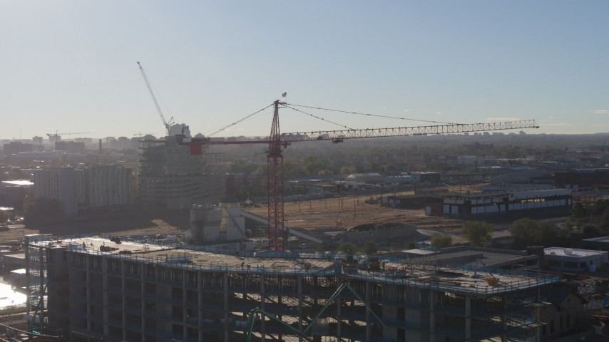 5.7K stock footage aerial video of a crane atop a building under construction at sunrise in Downtown Denver, Colorado Aerial Stock Footage | DX0001_001649