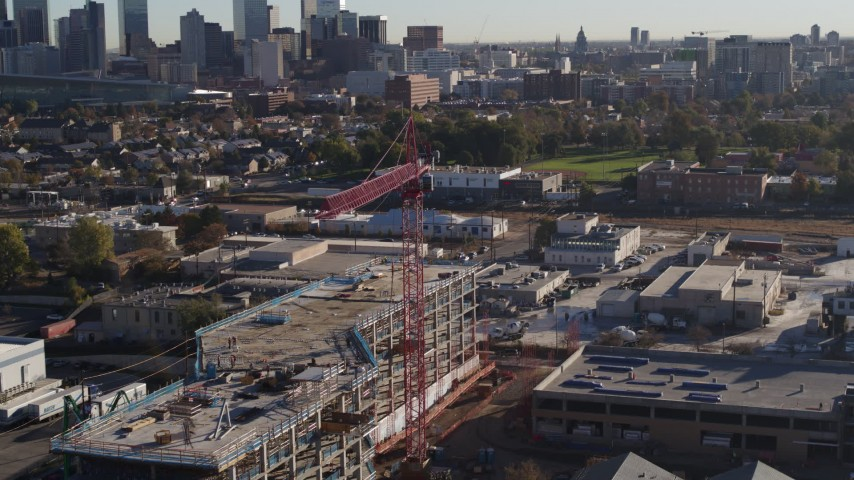 5.7K stock footage aerial video circle a crane atop a building under construction at sunrise in Downtown Denver, Colorado Aerial Stock Footage | DX0001_001651