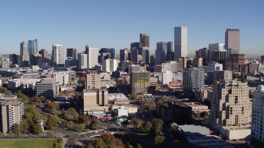 5.7K stock footage aerial video of the city's skyline, while passing office and apartment buildings in foreground, Downtown Denver, Colorado Aerial Stock Footage | DX0001_001669