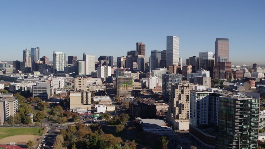 5.7K stock footage aerial video of the city's skyline behind apartment and office buildings, Downtown Denver, Colorado Aerial Stock Footage | DX0001_001676