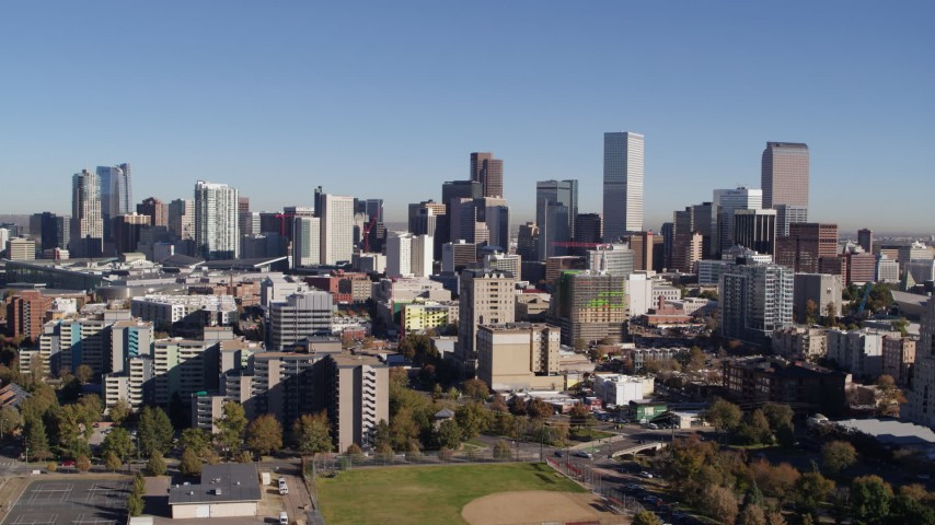 5.7K stock footage aerial video of flyby the city's skyline descend behind office buildings, Downtown Denver, Colorado Aerial Stock Footage | DX0001_001677