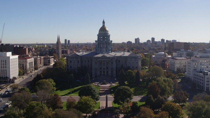 5.7K stock footage aerial video of a reverse view of the Colorado State Capitol building in Downtown Denver, Colorado Aerial Stock Footage | DX0001_001679