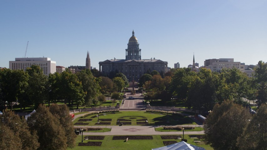 5.7K stock footage aerial video ascend to approach the Colorado State Capitol, Downtown Denver, Colorado Aerial Stock Footage DX0001_001681 | Axiom Images