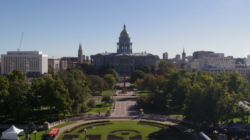5.7K stock footage aerial video of the Colorado State Capitol while descending toward park, Downtown Denver, Colorado Aerial Stock Footage | DX0001_001683