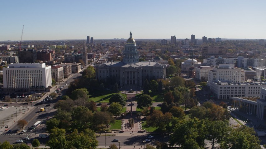 5.7K stock footage aerial video ascend from park for stationary view of the Colorado State Capitol, Downtown Denver, Colorado Aerial Stock Footage DX0001_001684 | Axiom Images