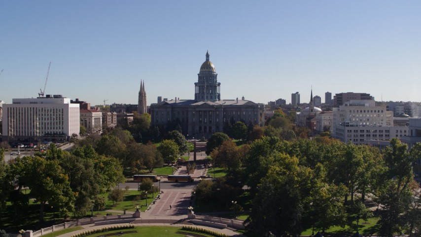 5.7K stock footage aerial video of flying by the Colorado State Capitol building, Downtown Denver, Colorado Aerial Stock Footage | DX0001_001688