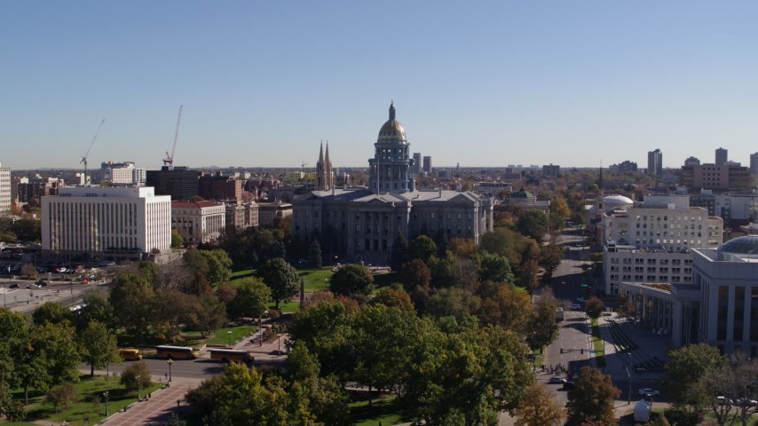 5.7K stock footage aerial video of the Colorado State Capitol building, seen while ascending from park, Downtown Denver, Colorado Aerial Stock Footage | DX0001_001689