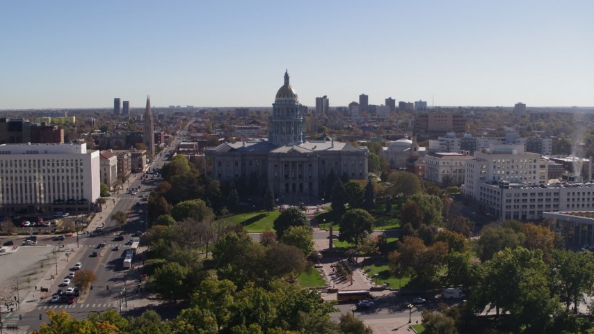 5.7K stock footage aerial video of a view of the Colorado State Capitol building, seen while flying over park, Downtown Denver, Colorado Aerial Stock Footage | DX0001_001691