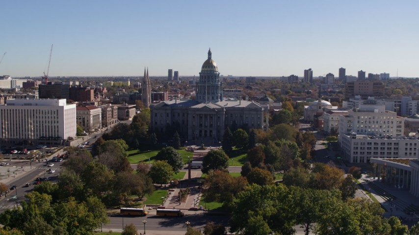 5.7K stock footage aerial video of a view of the Colorado State Capitol building, seen from the park, Downtown Denver, Colorado Aerial Stock Footage | DX0001_001692