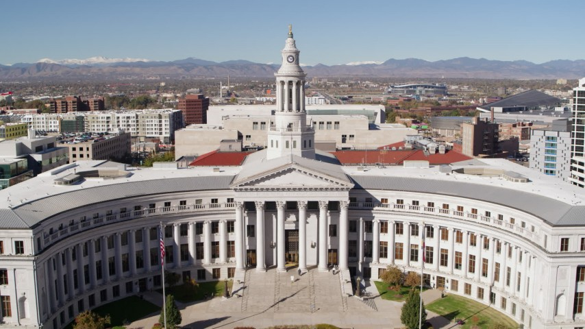 5.7K stock footage aerial video of flying by the Denver City Council building, Downtown Denver, Colorado Aerial Stock Footage | DX0001_001693