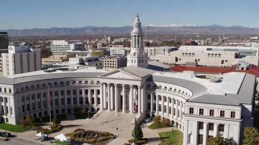 5.7K stock footage aerial video of passing by the Denver City Council building, Downtown Denver, Colorado Aerial Stock Footage | DX0001_001694