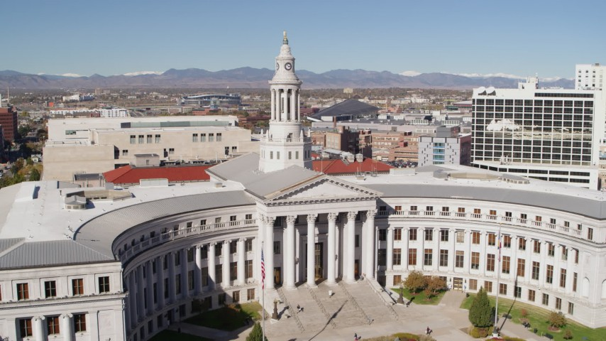 5.7K stock footage aerial video of passing the Denver City Council building while ascending, Downtown Denver, Colorado Aerial Stock Footage | DX0001_001695