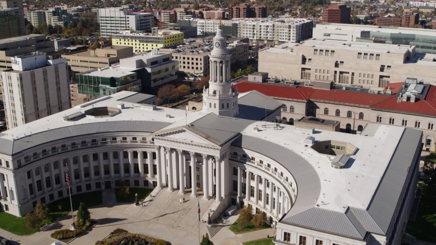 5.7K stock footage aerial video descend while passing the Denver City Council building, Downtown Denver, Colorado Aerial Stock Footage | DX0001_001696