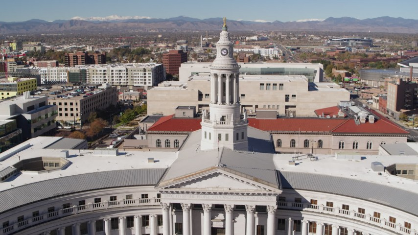 5.7K stock footage aerial video approach the Denver City Council building and ascend, Downtown Denver, Colorado Aerial Stock Footage | DX0001_001699