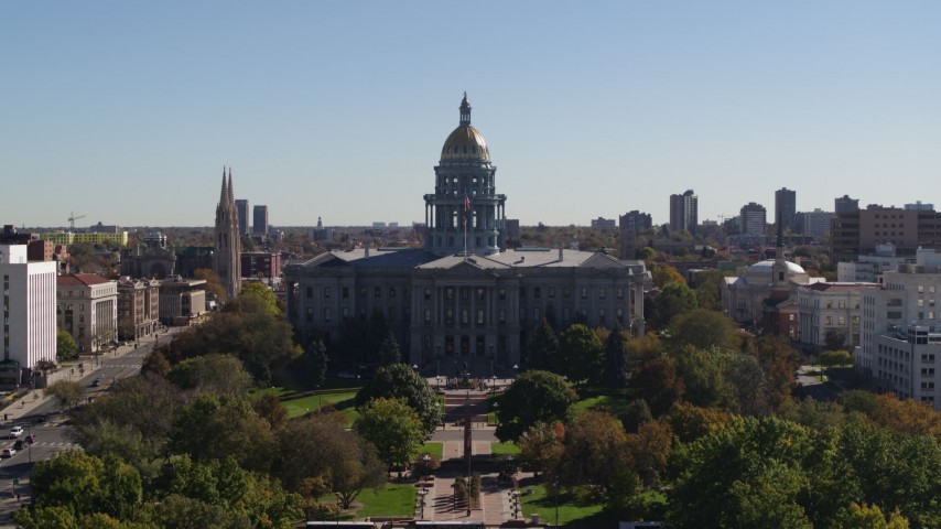 5.7K stock footage aerial video ascend from park while focusing on Colorado State Capitol, Downtown Denver, Colorado Aerial Stock Footage | DX0001_001700