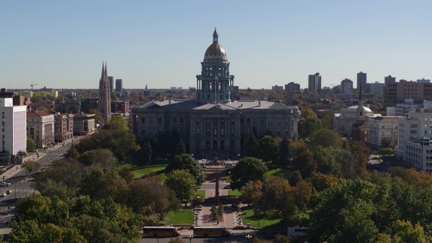 5.7K stock footage aerial video descend toward park while focusing on Colorado State Capitol, Downtown Denver, Colorado Aerial Stock Footage | DX0001_001701