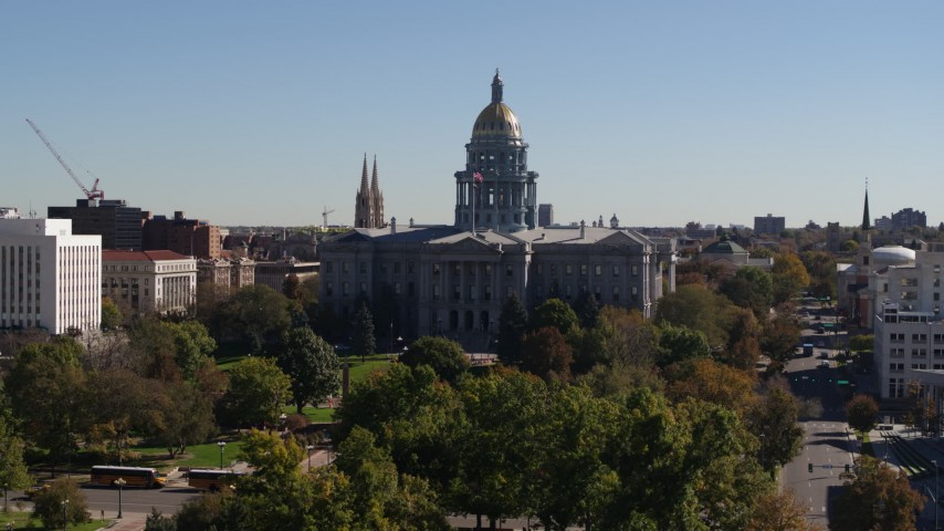 5.7K stock footage aerial video of passing by the Colorado State Capitol during descent, Downtown Denver, Colorado Aerial Stock Footage | DX0001_001705