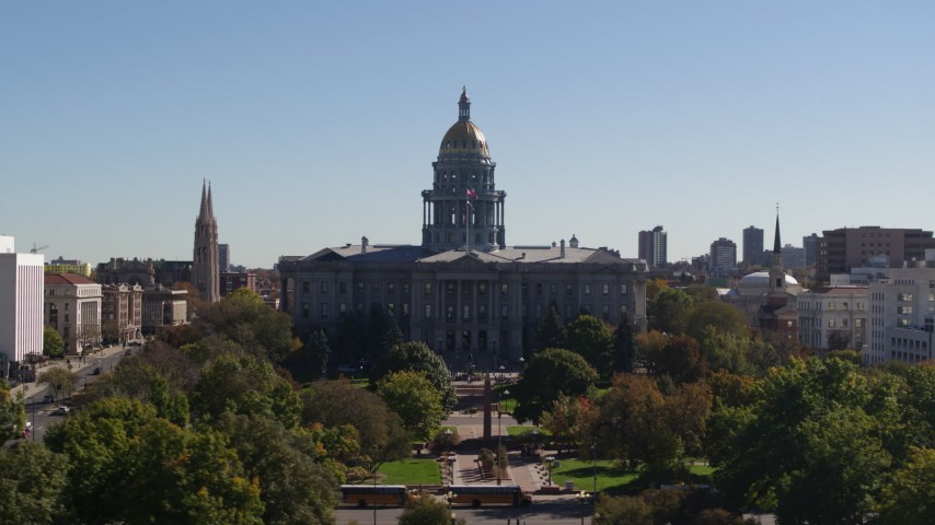 5.7K stock footage aerial video of passing by the Colorado State Capitol during ascent, Downtown Denver, Colorado Aerial Stock Footage | DX0001_001706