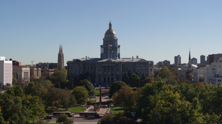 5.7K stock footage aerial video flyby the Colorado State Capitol during ascent from park, Downtown Denver, Colorado Aerial Stock Footage DX0001_001708 | Axiom Images