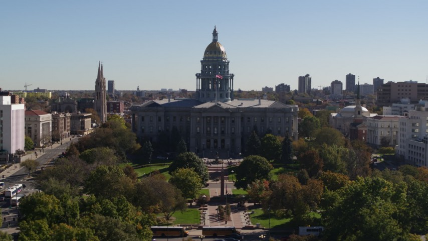 5.7K stock footage aerial video flyby the Colorado State Capitol during during descent toward trees, Downtown Denver, Colorado Aerial Stock Footage | DX0001_001709