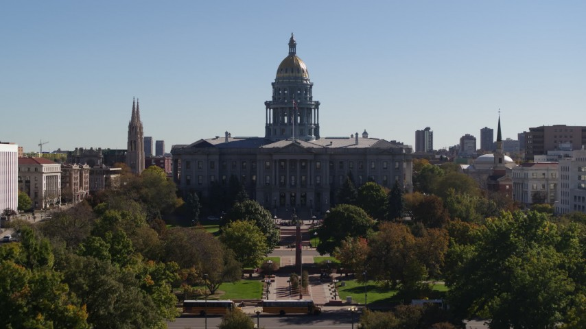 5.7K stock footage aerial video reverse view of the Colorado State Capitol during descent to park, Downtown Denver, Colorado Aerial Stock Footage | DX0001_001715