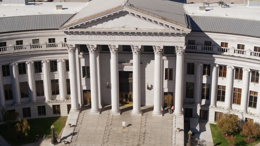 5.7K stock footage aerial video a close-up view of front of the Denver City Council in Downtown Denver, Colorado Aerial Stock Footage | DX0001_001719