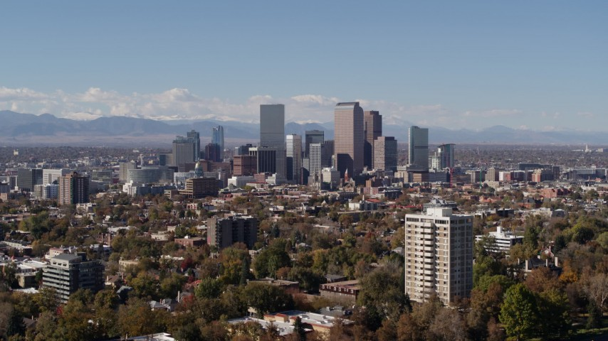 5.7K stock footage aerial video of the city's skyline and mountains in the background, Downtown Denver, Colorado Aerial Stock Footage | DX0001_001720