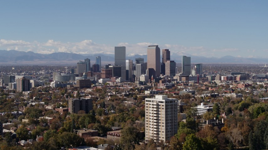 5.7K stock footage aerial video of the city's skyline with mountains in the background, Downtown Denver, Colorado Aerial Stock Footage | DX0001_001721