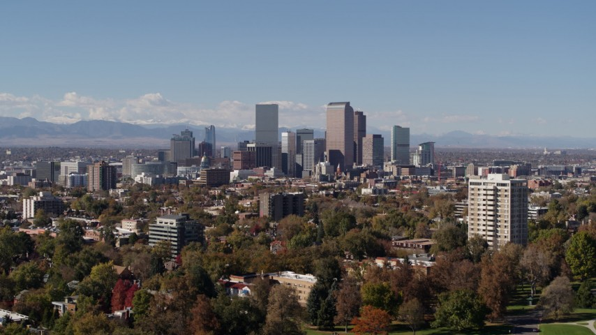 5.7K stock footage aerial video of the city's skyline with mountains in the background, seen during descent, Downtown Denver, Colorado Aerial Stock Footage | DX0001_001722