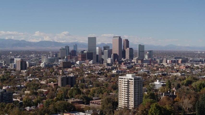 5.7K stock footage aerial video of the city's skyline with mountains in the background, seen during ascent, Downtown Denver, Colorado Aerial Stock Footage | DX0001_001723