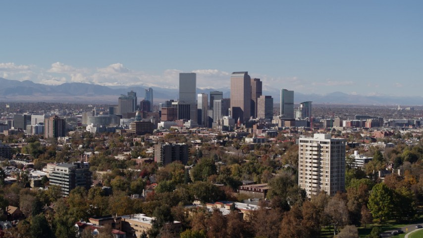 5.7K stock footage aerial video of the city's skyline with mountains in the background, seen during descent, Downtown Denver, Colorado Aerial Stock Footage | DX0001_001724