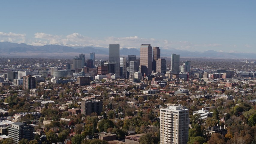 5.7K stock footage aerial video of wide view of the city's skyline, mountains in distance, Downtown Denver, Colorado Aerial Stock Footage | DX0001_001728