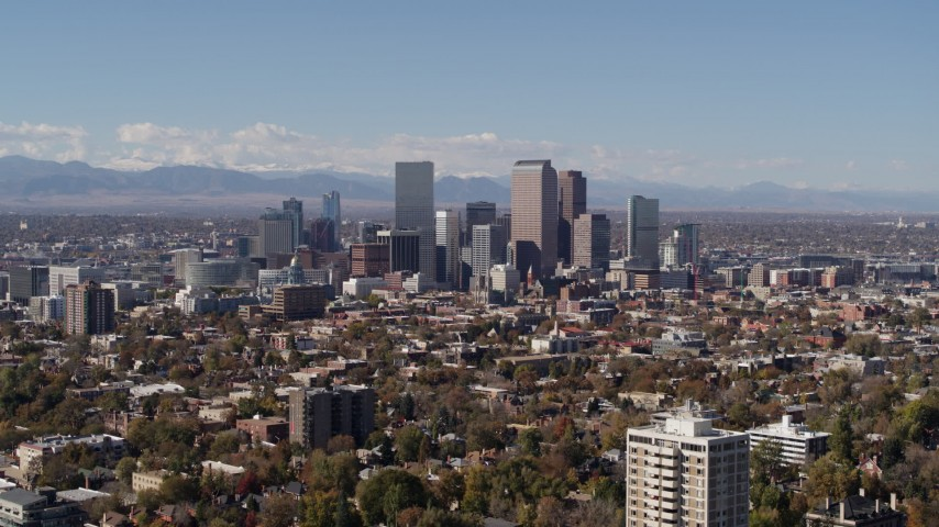 5.7K stock footage aerial video of slow approach to the city's skyline, mountains in distance, Downtown Denver, Colorado Aerial Stock Footage | DX0001_001729