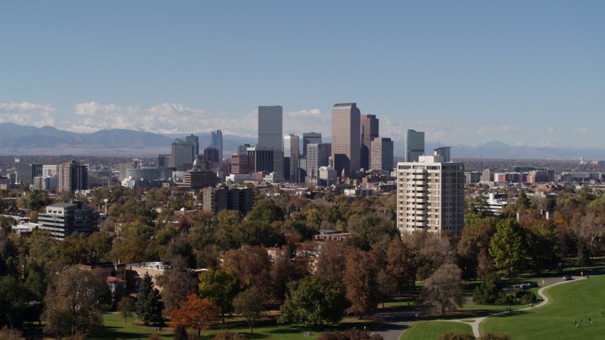 5.7K stock footage aerial video of the city's skyline, mountains in distance, seen while descending, Downtown Denver, Colorado Aerial Stock Footage | DX0001_001730
