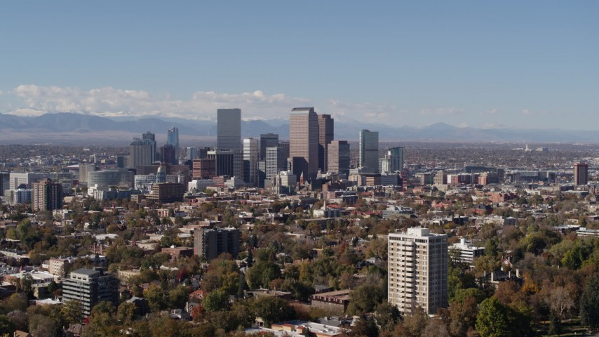 5.7K stock footage aerial video wider view of the city's skyline, with the mountains in background, Downtown Denver, Colorado Aerial Stock Footage | DX0001_001733