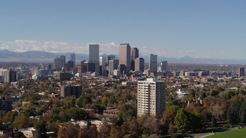 5.7K stock footage aerial video the city's skyline, with the mountains in background, Downtown Denver, Colorado Aerial Stock Footage | DX0001_001735