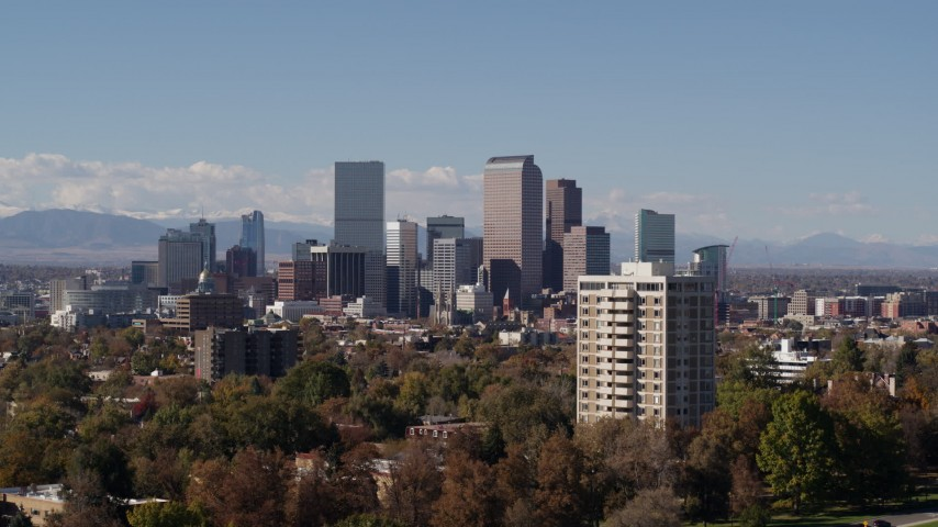 5.7K stock footage aerial video pass the city's skyline before ascending, Downtown Denver, Colorado Aerial Stock Footage | DX0001_001737