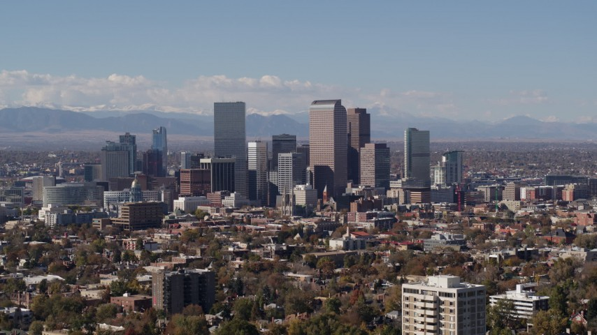 5.7K stock footage aerial video passing the city's skyline with mountains in background, Downtown Denver, Colorado Aerial Stock Footage | DX0001_001738