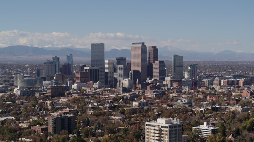 5.7K stock footage aerial video slowly passing the city's skyline with mountains in background, Downtown Denver, Colorado Aerial Stock Footage | DX0001_001739
