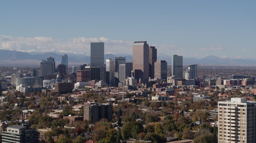 5.7K stock footage aerial video slow ascent by the city's skyline with mountains in background, Downtown Denver, Colorado Aerial Stock Footage | DX0001_001741