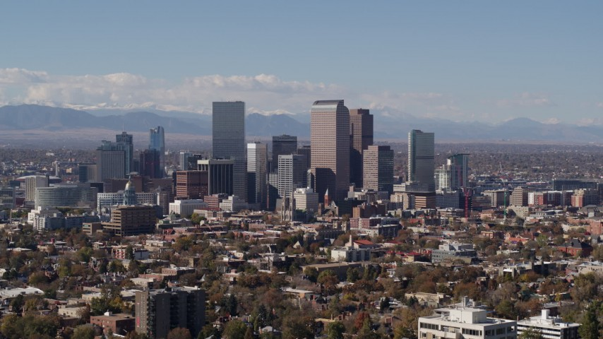 5.7K stock footage aerial video slow ascent by the city's skyline with mountains in distance, Downtown Denver, Colorado Aerial Stock Footage | DX0001_001742