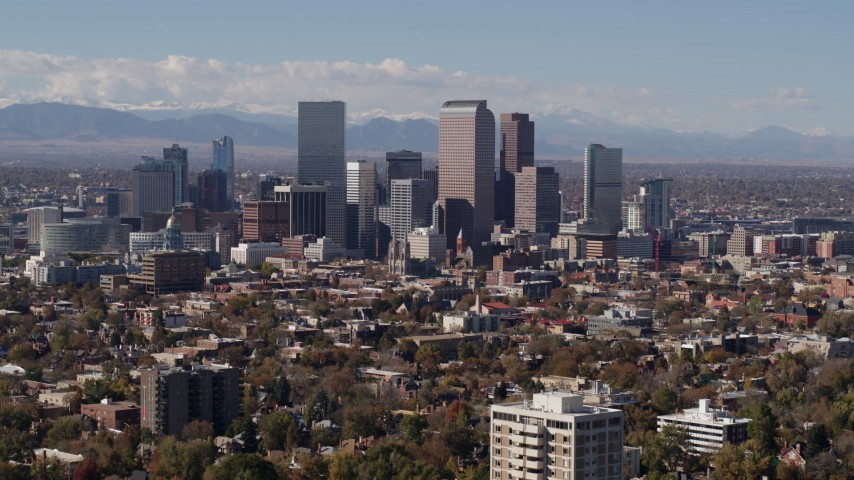 5.7K stock footage aerial video of focusing on the city's skyline with mountains in distance, Downtown Denver, Colorado Aerial Stock Footage | DX0001_001745