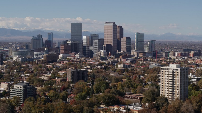 5.7K stock footage aerial video of focusing on the city's skyline with mountains in distance during descent, Downtown Denver, Colorado Aerial Stock Footage | DX0001_001746