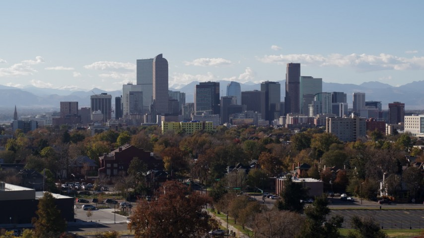 5.7K stock footage aerial video of focusing on the city's skyline, revealing a clock tower, Downtown Denver, Colorado Aerial Stock Footage | DX0001_001747